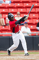 Guillermo Pimentel #3 of the Hickory Crawdads follows through on his swing against the Kannapolis Intimidators at  L.P. Frans Stadium August 1, 2010, in Hickory, North Carolina.  Photo by Brian Westerholt / Four Seam Images