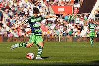 Ki Sung-Yueng shoots at goal during the Barclays Premier League match between Southampton v Swansea City played at St Mary's Stadium, Southampton