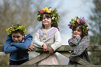 BNPS.co.uk (01202 558833)<br /> Pic: ZacharyCulpin/BNPS <br /> <br /> Weather input - <br /> <br /> Crowning glories: Dorset Flower Farmers, the Priestley family perfect their flower crown-making ahead of Garden Day on Sunday 9th May, the nationwide celebration of the benefits of gardens for health and wellbeing.  <br /> <br /> Pictured: Siblings Milo, 9, and Arabella, 5, Isadora Priestley. 7 show off their flower crowns in the garden<br /> <br /> Garden Day will be back for a third successive year on Sunday, 9th May 2021 to celebrate outdoor and indoor garden spaces. The nationwide  movement is calling on plant-lovers to make a flower crown, and share their plant spaces with family and<br /> friends