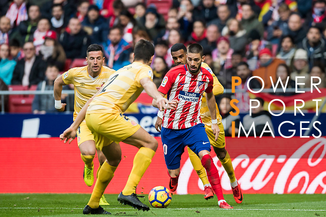 Yannick Ferreira Carrasco (R)  of Atletico de Madrid fights for the ball with players of Girona FC during the La Liga 2017-18 match between Atletico de Madrid and Girona FC at Wanda Metropolitano on 20 January 2018 in Madrid, Spain. Photo by Diego Gonzalez / Power Sport Images