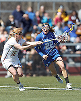 Duke University midfielder Molly Quirke (22) on the attack as Boston College defender Kara O'Connell (10) defends.Boston College (white) defeated Duke University (blue), 10-9, on the Newton Campus Lacrosse Field at Boston College, on April 6, 2013.