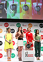 E-girls members attend a promotional event for Mr Donut