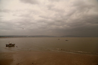An unusually orange cloud over Swansea Bay as seen from the seaside village of Mumbles