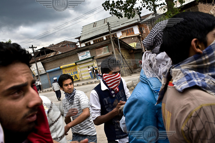 Protestors clash with Indian police during a protest in downtown Srinagar, the day after Kashmir went to the polls in the Indian national elections.