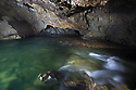 Underground river flowing through the Postojna Cave system. Slovenia. March.