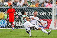 Beram Kayal (33) of Celtic F. C. collides with Sergio Ramos (4) of Real Madrid. Real Madrid defeated Celtic F. C. 2-0 during a 2012 Herbalife World Football Challenge match at Lincoln Financial Field in Philadelphia, PA, on August 11, 2012.