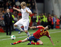 Spain's Sergio Busquets (r) and Finland's Pukki during international match of the qualifiers for the FIFA World Cup Brazil 2014.March 22,2013.(ALTERPHOTOS/Victor Blanco)