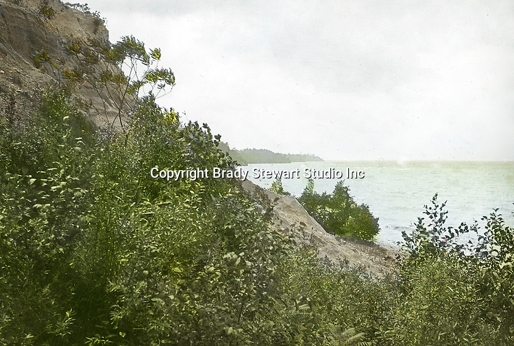 View of the Lake Erie Shoreline.  To give family and friends a better feel for the adventure, he hand-color black and white negatives into full-color 3x4 lantern slides.  The Process:  He contacted a negative with another negative to create a positive slide.  He then selected a fine brush and colors and meticulously created full color slides.