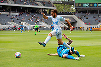 LOS ANGELES, CA - MAY 29: Diego Rossi #9 of LAFC leaps over a sliding Maxime Chanot #4 during a game between New York City FC and Los Angeles FC at Banc of California Stadium on May 29, 2021 in Los Angeles, California.