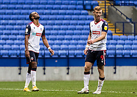 Bolton Wanderers' Nathan Delfouneso (left) and Eoin Doyle rue a near miss <br /> <br /> Photographer Andrew Kearns/CameraSport<br /> <br /> The EFL Sky Bet League Two - Bolton Wanderers v Oldham Athletic - Saturday 17th October 2020 - University of Bolton Stadium - Bolton<br /> <br /> World Copyright © 2020 CameraSport. All rights reserved. 43 Linden Ave. Countesthorpe. Leicester. England. LE8 5PG - Tel: +44 (0) 116 277 4147 - admin@camerasport.com - www.camerasport.com