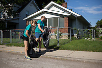 """Sally Finkel, left, and Molly Baumann pick up trash in the Hawthorne neighborhood during """"Circle the City with Service,"""" the Kiwanis Circle K International's 2015 Large Scale Service Project, on Wednesday, June 24, 2015, in Indianapolis. (Photo by James Brosher)"""