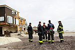 BELLE HARBOR, NEW YORK-NOVEMBER 01: Firemen check on residents of this Rockaway, Queens neighborhood after Hurricane Sandy November 1, 2012. A large number of homes and businesses were destroyed by the storm and much of the area is without power.