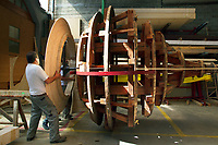 Switzerland. Geneva. Two carpenters from the roofing company « Cerutti Toitures SA » control, repair and manufacture new wooden frames for the central onion dome of the Russian Orthodox Church (full name: Cathédrale de l'Exaltation de la Sainte Croix). The giant bulb underwent a complete revival restoration. The church is a lovely 19th-century Russian Orthodox church topped with golden onion domes. An onion dome is a dome whose shape resembles an onion. Such domes are often larger in diameter than the drum upon which they sit, and their height usually exceeds their width. These bulbous structures taper smoothly to a point. 27.05.2016 © 2016 Didier Ruef