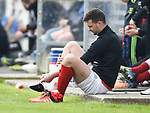 An injured Stephen Kelly of Newmarket sits out the rest of their Munster Junior Cup semi-final at Limerick. Photograph by John Kelly.