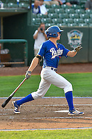 Gavin Lux (7) of the Ogden Raptors follows through on his swing against the Idaho Falls Chukars during the Pacific Coast League game at Smith's Ballpark on August 29, 2016 in Salt Lake City, Utah. The Chukars defeated the Raptors 3-0. (Stephen Smith/Four Seam Images)