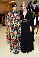 """Laura Mulleavy, left, Kate Mulleavy attend The Metropolitan Museum of Art's Costume Institute benefit gala celebrating the opening of the """"In America: A Lexicon of Fashion"""" exhibition on Monday, Sept. 13, 2021, in New York. (Photo by Evan Agostini/Invision/AP)"""