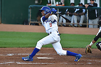 Melvin Santana (9) of the Ogden Raptors at bat against the Grand Junction Rockies during Opening Night of the Pioneer League Season on June 16, 2014 at Lindquist Field in Ogden, Utah. (Stephen Smith/Four Seam Images)
