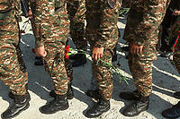 Nagorno-Karabakh, also known as Artsakh, is a landlocked region in the South Caucasus. Stepanakert is the capital and the largest city of the Republic of Artsakh (better known as Nagorno-Karabakh). Soldiers with flowers on a sunny Sunday morning at War Memorial. Ceremony for Ashot  Ghulyan (1959-1992), also known as Bekor (Shard). He was an Armenian military leader, killed during the Nagorno-Karabakh war (1988 -1994), and awarded the Hero of Artsakh honorary title. Nagorno-Karabakh is a disputed territory, internationally recognized as part of Azerbaijan, but most of the region is governed by the Republic of Artsakh (formerly named Nagorno-Karabakh Republic), a de facto independent state with Armenian ethnic population. Since 1994, regular peace talks between Armenia and Azerbaijan mediated by the OSCE Minsk Group have failed to result in a peace treaty. The territory is under the control of the Artsakh Defense Army (which is backed up by Armenian Army) due to the ongoing territorial disputes with Azerbaijan. 6.10.2019 © 2019 Didier Ruef