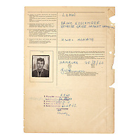 BNPS.co.uk (01202) 558833. <br /> Pic: Bonhams/BNPS<br /> <br /> Pictured: The passport picture of John Lennon on the document which is dated 25/8/60. <br /> <br /> A collection of travel documents relating to the Beatles legendary trips to Hamburg have sold at auction for almost £140,000.<br /> <br /> The documents, including John Lennon's VISA permits, date back to the early 60s, when the band would regularly play gigs in the German city.<br /> <br /> The first temporary residency permit is dated August 16, 1960 and lists all five members of the Beatles at that time (including drummer Pete Best) and their Liverpool addresses.