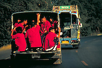 Thai kids wearing red shirts crowded in the back of a panel truck driving on highway. Safety. Bangkok, Thailand.