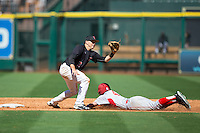Michael Davis (3) of the Texas Tech Red Raiders fields a throw as Zac Taylor (4) of the Houston Cougars slides into second base at Minute Maid Park on February 26, 2016 in Houston, Texas.  The Red Raiders defeated the Cougars 3-2 in game one of the 2016 Shriners Hospitals for Children College Classic.  (Brian Westerholt/Four Seam Images)