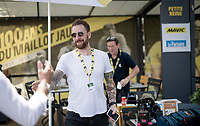 """Sir Bradley Wiggins, here as a commentator for Eurosport, at the race start in Tarbes. His badge says """"expert""""... <br /> <br /> Stage 14: Tarbes to Tourmalet(117km)<br /> 106th Tour de France 2019 (2.UWT)<br /> <br /> ©kramon"""