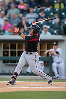 Oswaldo Arcia (31) of the Rochester Red Wings follows through on his swing against the Charlotte Knights at BB&T BallPark on August 8, 2015 in Charlotte, North Carolina.  The Red Wings defeated the Knights 3-0.  (Brian Westerholt/Four Seam Images)