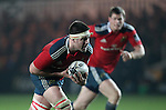 Second row Billy Holland of Munster Rugby carries the ball forwards for Munster.<br /> <br /> Guiness Pro 12<br /> Newport Gwent Dragons v Munster Rugby<br /> Rodney Parade<br /> 21.11.14<br /> ©Steve Pope-SPORTINGWALES