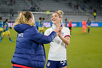 ORLANDO, FL - JANUARY 18: Sisters Samantha Mewis #3 and Kristie Mewis #22 of the United States celebrate a USA victory together during a game between Colombia and USWNT at Exploria Stadium on January 18, 2021 in Orlando, Florida.