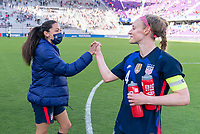 ORLANDO, FL - FEBRUARY 21: Christen Press #23 shakes hands with Becky Sauerbrunn #4 of the USWNT after a game between Brazil and USWNT at Exploria Stadium on February 21, 2021 in Orlando, Florida.
