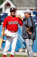 June 19, 2009:  Coach Ramon Ortiz of the Batavia Muckdogs talks with Dennis Holmberg before a game at Dwyer Stadium in Batavia, NY.  The Muckdogs are the NY-Penn League Short-Season Class-A affiliate of the St. Louis Cardinals.  Photo by:  Mike Janes/Four Seam Images