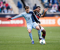 Bobby Convey (11) of Sporting Kansas City fights for the ball with Amobi Okugo (14) of  the Philadelphia Union during the game at PPL Park in Chester, PA.  Kansas City defeated Philadelphia, 3-1.