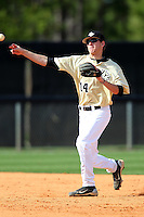 UCF Knights second baseman Tommy Williams #14 throws to first during a game against the Siena Saints at the UCF Baseball Complex on March 4, 2012 in Orlando, Florida.  Central Florida defeated Siena 15-2.  (Mike Janes/Four Seam Images)