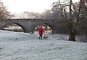 24/11/14<br /> <br /> Surrounded by frost, a woman walks her dogs along banks of the river Dove, near Ellastone, on the Derbyshire, Staffordshire border after temperatures plummet below freezing over-night.<br /> <br /> <br /> ***ANY UK EDITORIAL PRINT USE WILL ATTRACT A MINIMUM FEE OF £130. THIS IS STRICTLY A MINIMUM. USUAL SPACE-RATES WILL APPLY TO IMAGES THAT WOULD NORMALLY ATTRACT A HIGHER FEE .  PRICE FOR WEB USE WILL BE NEGOTIATED SEPARATELY***<br /> <br /> <br /> All Rights Reserved - F Stop Press.  www.fstoppress.com. Tel: +44 (0)1335 300098
