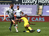 17th April 2021; Liberty Stadium, Swansea, Glamorgan, Wales; English Football League Championship Football, Swansea City versus Wycombe Wanderers; Dennis Adeniran of Wycombe Wanderers slides in to win the ball from Conor Hourihane of Swansea City