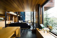 The cedar panelling used throughout the house is particularly noticeable in the dining area which is furnished with a maple table