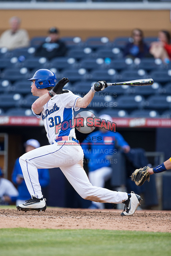 James Ziemba (30) of the Duke Blue Devils follows through on his swing against the California Golden Bears at Durham Bulls Athletic Park on February 20, 2016 in Durham, North Carolina.  The Blue Devils defeated the Golden Bears 6-5 in 10 innings.  (Brian Westerholt/Four Seam Images)