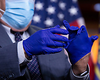 United States Representative G. K. Butterfield (Democrat of North Carolina) puts on protective gloves prior to a news conference at the United States Capitol in Washington D.C., U.S., on Wednesday, June 24, 2020.  Credit: Stefani Reynolds / CNP/AdMedia