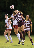 Hawgs Illustrated/BEN GOFF <br /> Stefani Doyle (17) of Arkansas jumps for a header against Addie McCain of Texas A&M in the second half Thursday, Sept. 20, 2018, at Razorback Field in Fayetteville.