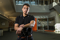 Business Management senior and media entrepreneur Chidi Iwuoha photographed in front of the Weidner Center in UAA's Rasmuson Hall.