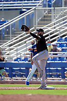 Pittsburgh Pirates first baseman Will Craig (35) stretches for a throw during a Major League Spring Training game against the Toronto Blue Jays on March 1, 2021 at TD Ballpark in Dunedin, Florida.  (Mike Janes/Four Seam Images)