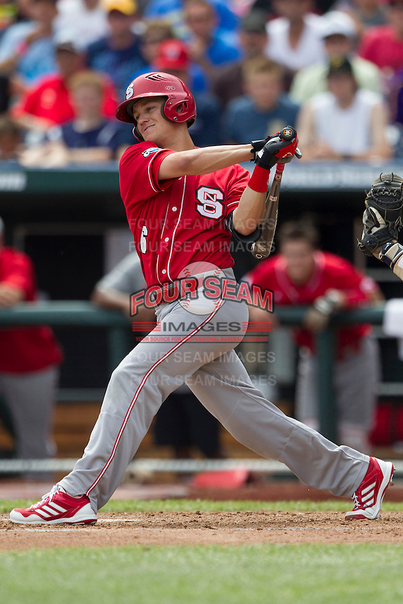 North Carolina State second baseman Logan Ratledge (6) follows through on his swing during Game 3 of the 2013 Men's College World Series between the North Carolina State Wolfpack and North Carolina Tar Heels at TD Ameritrade Park on June 16, 2013 in Omaha, Nebraska. The Wolfpack defeated the Tar Heels 8-1. (Andrew Woolley/Four Seam Images)
