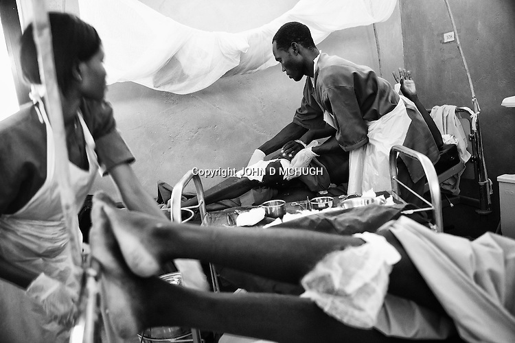 Wounded soldiers are treated in a hospital at  an undisclosed location in South Kordofan, 5 July 2011. On the 5 June, after almost 10 years of relative peace, Sudan's President Omar Al-Bashir sent his army, the Sudan Armed Forces (SAF), to attack on the people of the Nuba Mountains in South Kordofan, using MiG fighters to shoot at vehicles, and Antonov cargo planes, converted to use as heavy bombers. (John D McHugh)