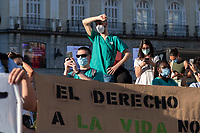 MADRID, SPAIN - JUNE 29: A man covers his face to protect himself from the sun during a protest held in the afternoon in Puerta del Sol to request better working conditions, protection equipment and investment in Health to fight against the covid-19 on June 29 2020, in Madrid, Spain. The region of Madrid was the main focus of covid-19 outbreak in Spain. In al over the country, more than 50000 thousand health staff has been infected with the coronavirus since the beginning of the pandemic.(Photo by Sergio Belena/VIEWpress via Getty Images).