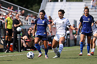 CARY, NC - SEPTEMBER 12: Debinha #10 of the North Carolina Courage and Rocky Rodriguez #11 of the Portland Thorns FC chase the ball during a game between Portland Thorns FC and North Carolina Courage at Sahlen's Stadium at WakeMed Soccer Park on September 12, 2021 in Cary, North Carolina.