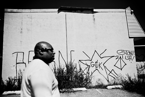 Camden New Jersey, USA<br /> August 2008<br /> <br /> A Camden County police officer looks for gang graffiti on the walls of a public park.