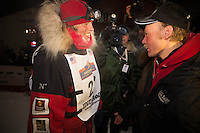 Aily Zirkle, left, greets with Iditarod winner Mitch Seavey after she pulled into Nome minutes after him on Tuesday March 12, 2013...Iditarod Sled Dog Race 2013..Photo by Jeff Schultz copyright 2013 DO NOT REPRODUCE WITHOUT PERMISSION