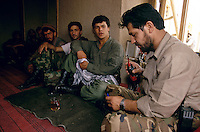 Commander Jalal i Din giving radio orders in is Kichim office, at the frontline against the Taleban force in Konduz. Din is the right hand of General Mohammad Quasim Fahim. Fahim was the right hand of warlord Ahmad Shah Massoud.