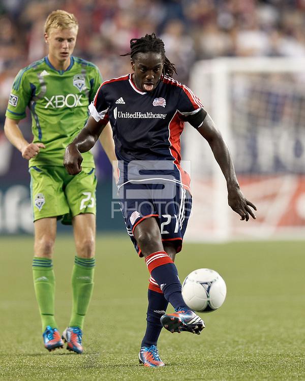 New England Revolution midfielder Shalrie Joseph (21) passes the ball. In a Major League Soccer (MLS) match, the New England Revolution tied the Seattle Sounders FC, 2-2, at Gillette Stadium on June 30, 2012.