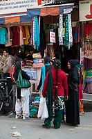India, Dehradun.  Women Shopping on a Market Street.